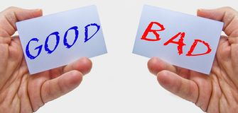 Good and bad choice signs in man hands on a white background. for business and education concepts royalty free stock photography