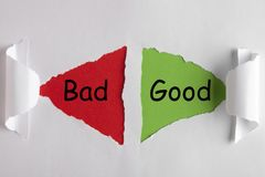 Good or Bad Concept. Good or Bad words on white torn paper with triangle shape. Business concept royalty free stock images