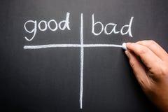 Good and Bad. Hand writing Good and Bad sorting table with chalk Stock Image
