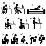 Good and Bad Human Body Posture Stick Figure Picto. A set of human pictogram representing the good and bad posture while sitting in front of a computer, motion Stock Photo