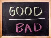 Good and bad word on blackboard Royalty Free Stock Photos
