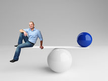 Good balance. Smiling man on 3d balance with blue ball Royalty Free Stock Images