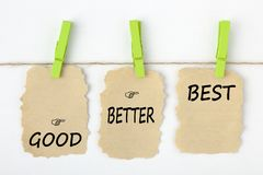Good Better Best Concept. GOOD BETTER BEST writen on old torn paper with clip hanging on white background. Business concept words royalty free stock image