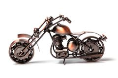 Handmade model of custom motorcycle bike. Copper scale model of chopper. Side view. on white royalty free stock photography