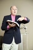 The Good Book. Minister preaching and pointing to the Bible Royalty Free Stock Photos