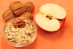Good breakfast. Oatmeal with nuts and apple royalty free stock photography