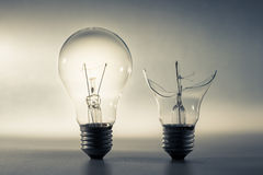 Good and Broken Light Bulb. Problem and solution, good idea and bad idea or comparison concept Stock Photos