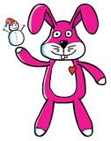 Good Bunny puppet. Represent a Good Bunny puppet showing up a tiny Snowman Royalty Free Stock Photo