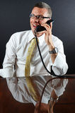 Good Business. Image of a smiling business man on the phone Stock Image