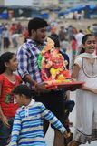 Good bye god. Devotees take out procession of lord Ganesh in the Religious festival of Ganesha immersion in sea water in India Royalty Free Stock Photos