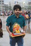 Good bye god. Devotees take out procession of lord Ganesh in the Religious festival of Ganesha immersion in sea water in India Stock Image