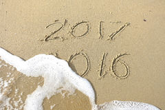 Good bye 2016 hello 2017. inscription written in the beach sand. Stock Photo