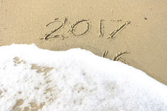 Good bye 2016 hello 2017. inscription written in the beach sand. Stock Images