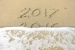 Good bye 2016 hello 2017. inscription written in the beach sand. Stock Image