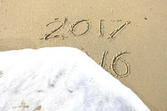 Good bye 2016 hello 2017. inscription written in the beach sand. Royalty Free Stock Photos