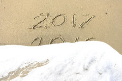 Good bye 2016 hello 2017. inscription written in the beach sand. Stock Photography