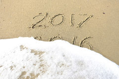 Good bye 2016 hello 2017. inscription written in the beach sand. Royalty Free Stock Images