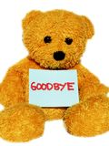 Good bye teddy bear. Golden teddy bear with a message written in red saying goodbye Stock Photography