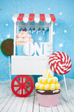 A good cart with the letters one with cakes and sweets. A good cart with the letters one with cakes and sweets Royalty Free Stock Image