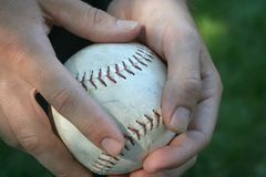 Good Catch. Hands holding a baseball Royalty Free Stock Photos