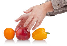 Good choice. Try to make right choice, hand and fruit Stock Photos