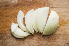 Good closeup of peeled onion on wooden desk Stock Photo