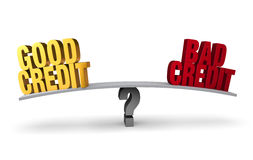 Good Credit Versus Bad Credit. Bright, gold GOOD CREDIT and red BAD CREDIT sit on opposite ends of a gray board which is balanced on a gray question mark.  on Royalty Free Stock Photos