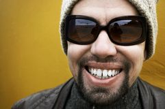 Good day!. Positive dude(special photo f/x and  dark vignetting , focus poit on the smile and on the sun glasses Royalty Free Stock Images