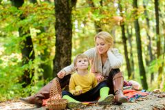 Free Good Day For Spring Picnic In Nature. Having Snack During Hike. Happy Childhood. Mom And Kid Boy Relaxing While Hiking Royalty Free Stock Images - 144906489