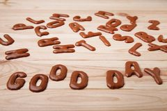Good Day. Written by chocolate cookies alphabet Royalty Free Stock Photo