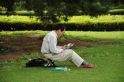 A Good Day. A mans doing his painting in Tokyo imperial palace Royalty Free Stock Photography