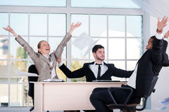 Good day. Three successful businessmen throwing documents up whi Stock Image