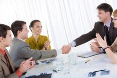 Good deal. Photo of successful business partners congratulsting each other after striking a deal stock images