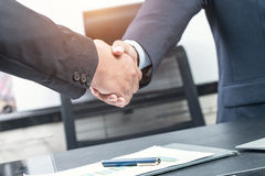 Good deal. Close-up of two business people shaking hands while  Stock Images