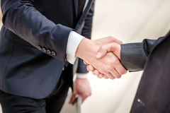 Good deal! Two young businessman standing opposite each other an Royalty Free Stock Photo