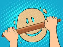 Good dough smiley face. Pop art retro style. The food and cooking. Housewife rolls out the dough with a rolling pin Royalty Free Stock Image