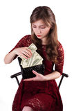 Good employee received a salary. Woman puts money in the wallet royalty free stock photos