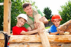 Good family constructing. Dad with his boys constructing at nature stock photos