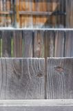 Good fences make good neighbors. A beautiful photograph of the tops of fence boards looking onto the blurred fences in the back ground Royalty Free Stock Photography