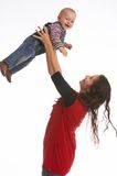 Good flight. Mother lifting her baby up stock photo