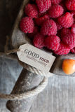 Good food healthy Eating. Tag with the inscription and raspberries Royalty Free Stock Photos