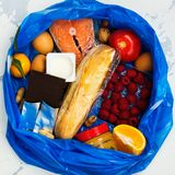 Good food in trash bag Stock Photo