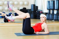Good form. Young sporty woman in the gym centre royalty free stock photos