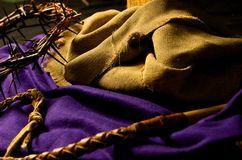 Good Friday. Crown of Thorns, whip, robes at the foot of the cross of Jesus Royalty Free Stock Photography