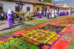 Good Friday carpet, Antigua, Guatemala. Antigua, Guatemala - March 25, 2016: Locals reenact biblical scenes with processions walking over handmade dyed sawdust stock photo