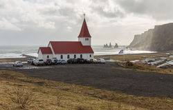 Good Friday church service at Vik, Iceland. The Good Friday church service at Vik, Iceland. As locals join the service, the carpark of Reynir`s Church fills up stock images