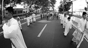 Good Friday Procession Black and White. MANILA- APR. 2: Altar boys and members of the AFP General Headquarters military band march during the Good Friday Stock Photos