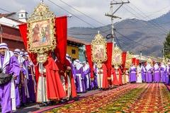 Good Friday procession beside dyed sawdust carpet, Antigua, Guatemala stock photo