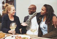 Good friends enjoying dinner Stock Image