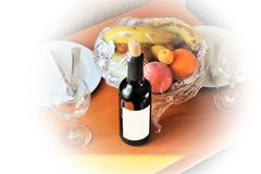 Beautiful still life in a Turkish hotel with fruit and a bottle of birthday wine. stock photography